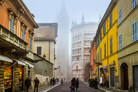 Street view of Baptistery and Duomo tower in Parma, Emlia-Romagna, Italy. Stock Photo