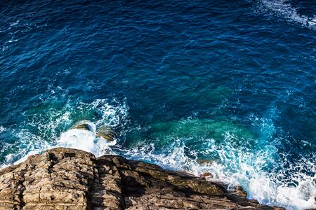 Rocky coast line and sea waves.