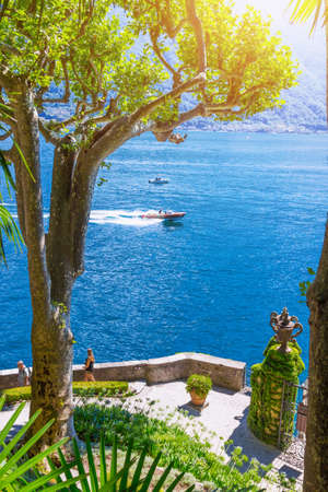 View of beautiful lake through the trees, Como lake, Italy. Stock Photo