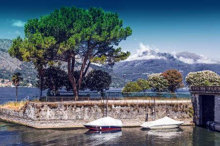 Boats at Como lake in summer, Italy
