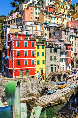 Hillside village of Riomaggiore with bright colored houses, Cinque Terre, Italy.