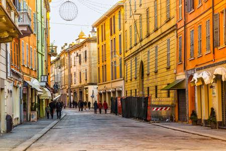 Street with yellow buildings in Reggio Emilia, Emilia-Romagna, Italy.