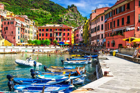 View of the boats and old Vernazza village, Cinque Terre, Italy.