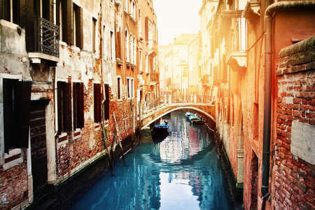 Beautiful old canal in Venice, Italy. Romantic atmosphere. Venice is historical Italian place. Stock Photo