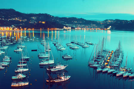 View above many sea yachts in the night in Lerici, Liguria, Italy.