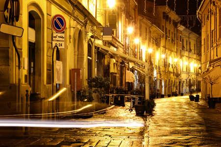 Old night street in Sarzana, Italy