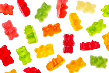Colorful jelly candy gummy bears falling over white background. Red, green, orange and yellow colors. Reklamní fotografie