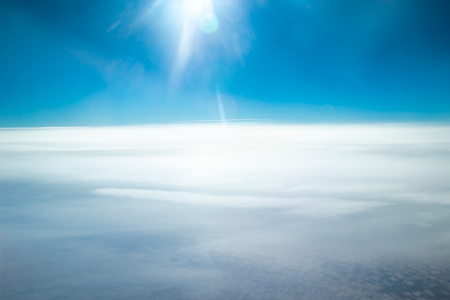 White clouds and blue sky with sun light. Cloudscape background.