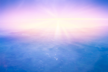 Sunset high above Earth. Horizon view. Beautiful sky background.