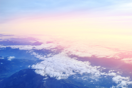 Aerial view above Alpine mountains at sunset. Panorama of Alps peaks. Beautiful Alpine mountains landscape.