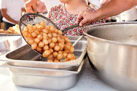 A pile of deep fried sweet potato dough balls Stockfoto