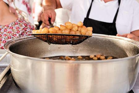 A pile of deep fried sweet potato dough balls