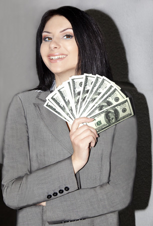woman holding money: young business woman holding money