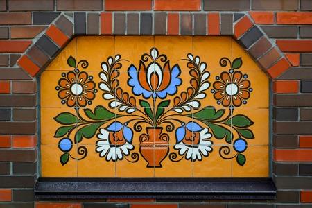 garniture: Ethnic ceramic decoration on the wall. Opishnya, Poltavska oblast, Ukraine.