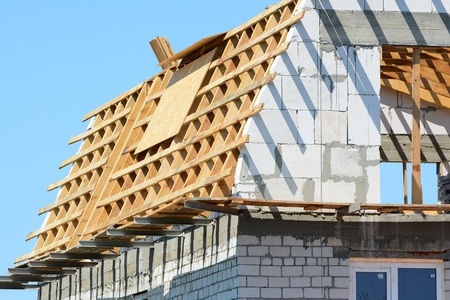 attic: Attic construction. Reconstruction of the wooden roof. Stock Photo
