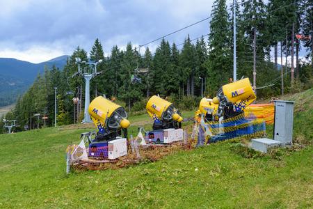 ski slopes: Snow gun. Snow making machine. Machine that makes artificial snow and blows it onto ski slopes.
