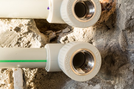 plastic conduit: Repair of the water supply system of plastic pipes. Stock Photo