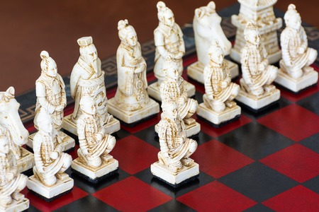 chess board: Board game of strategic skill for two players, played on a checkered board. Stock Photo