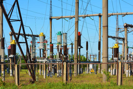 High-voltage power lines against the blue sky. Stock Photo
