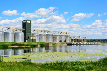 Grain elevator in agricultural zone. Granary with mechanical equipment for receiving, cleaning, drying, grain shipment.