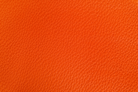 leathern: Background image of the texture of the leather, painted in orange.