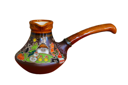 ewer: Traditional colored pottery, painted ceramic coffee pot. Isolated, white background.