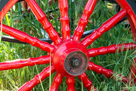 eldest: Red metal vintage wheel from the carriage close-up.