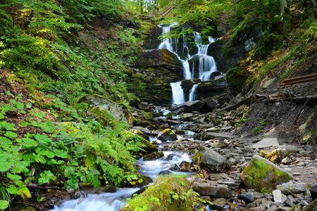 Waterfall Shypit in Pylypet, Zakarpatska oblast, Ukraine. Cascade in the autumn forest.