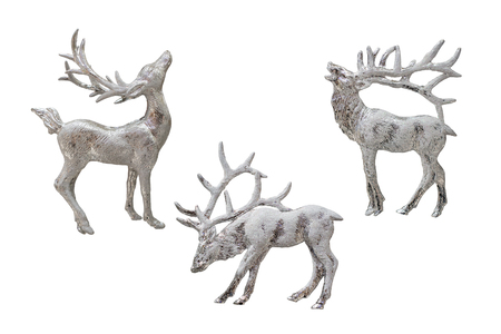 Christmas and New Year decorations: figurines of a reindeer. Isolated, white background.