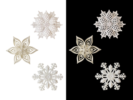 Christmas and New Year decorations: figurines of a snowflake. Isolated, black and white background.