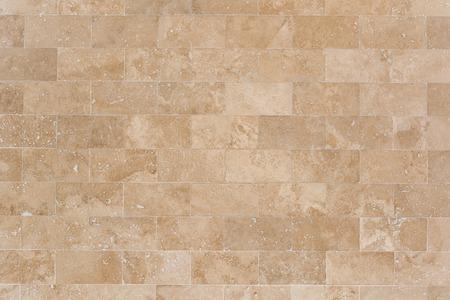 Revestimiento de piedra de pared beige de travertino. Textura de mampostería.