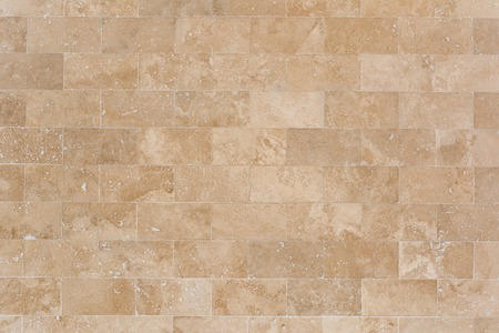 Stone facing of beige wall made of travertine. Texture of masonry. 写真素材 - 97503500