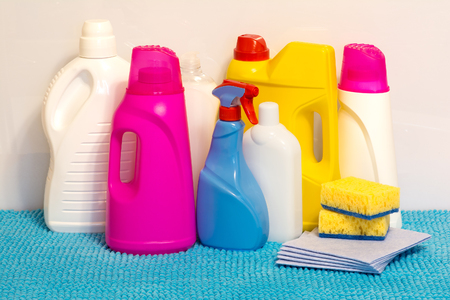 Set of multi-colored plastic containers for household chemicals, cleaning products for home use. Фото со стока