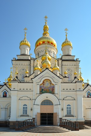 Religious building, Orthodox Christian cathedral with golden domes. Transfiguration Cathedral, Holy Dormition Pochayiv Lavra in Ukraine.