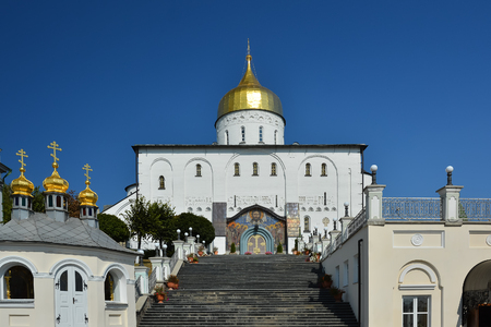Religious building, Orthodox Christian cathedral with golden domes. Trinity Cathedral, Holy Dormition Pochayiv Lavra in Ukraine.