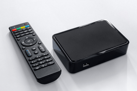 Iptv box and remote controller. Modern multimedia device for viewing television via the Internet, multimedia player and control panel. Stockfoto