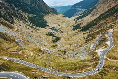 View of Transfagarash highway and valley in mountains of Romania. Tourist view mountain road. Autumn mountain landscape.