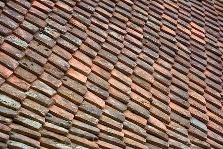 Antique ceramic multi-colored roof tiles. Background image of terracotta roof tiles closeup. Stok Fotoğraf