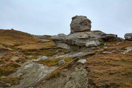 Mountain landscape in Bucegi Natural Park near Busteni, Romania. Megaliths on top of a mountain range, tourist attraction.