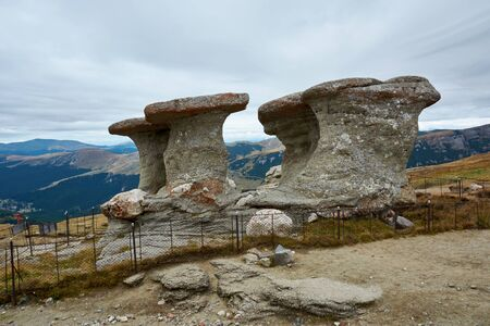 Babele Natural Monument, stone in the Bucegi Natural Park in Romania. Megaliths on top of a mountain range, tourist attraction.