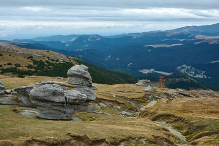 Huge sphinx-like stone in the Bucegi Natural Park in Romania. Megaliths on top of a mountain range, tourist attraction. Stok Fotoğraf