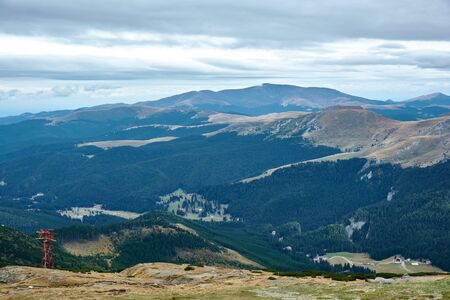 Mountain landscape in Bucegi Natural Park near Busteni, Romania. On top of a mountain range, tourist attraction.