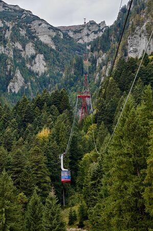 Mountain cable car, telecabin in the Bucegi Mountains. Mountain landscape in Bucegi Natural Park near Busteni, Romania.