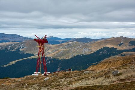Mountain landscape in Bucegi Natural Park near Busteni, Romania. Pylons of mountain cable car in the Bucegi Mountains. Reklamní fotografie
