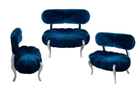 Fancy navy blue velvet armchair. Sapphirine sofa with velor upholstery. Isolated, white background.
