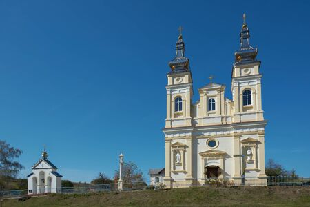 Ukrainian Greek Catholic Church of the Nativity of Blessed Virgin Mary in Krynytsya, Ternopil Oblast, Ukraine, GPS 49.05364, 25.10779. Stone religious building of Christian Cathedral. Stok Fotoğraf