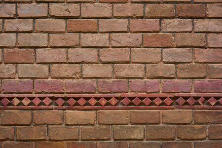 Red brick wall, оld brickwork. Texture of old ceramic brick. Texture, background.