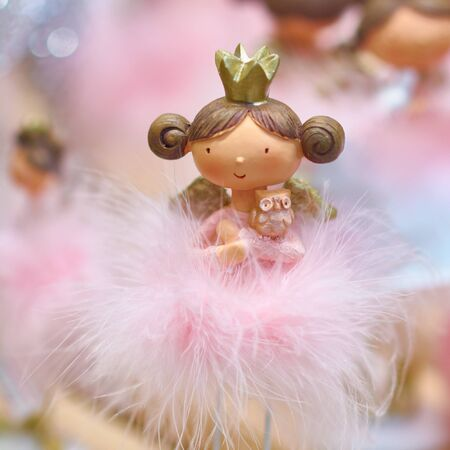 Doll princess in a pink dress with a crown. Toy princess, decorations for a Christmas tree or New Years tree. Stok Fotoğraf