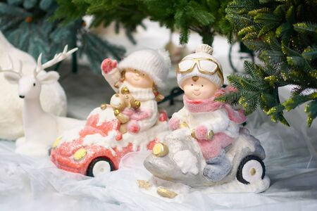 Toy boy and girl in cars. Christmas and New Years toys. Decorations for a Christmas tree or New Years tree. Stok Fotoğraf