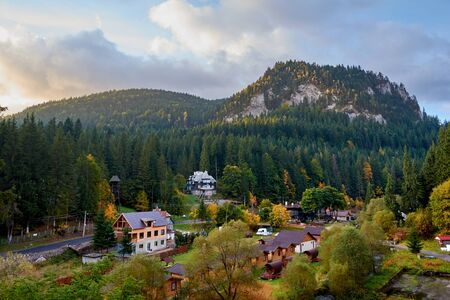 Mountain village Laku Rosu in the Carpathian mountains, Romania. Autumn mountain landscape.